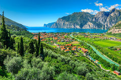 Beautiful sunny day on Lake Garda,Torbole.Italy,Europe. Lake Garda and Sarca river near Torbole town,Northern Italy,Europe Royalty Free Stock Photo