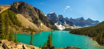 Sunny day at Moraine lake in Banff National Park, Alberta, Canada. Beautiful sunny day at Moraine lake in Banff National Park, Alberta, Canada, with snow-covered Stock Image