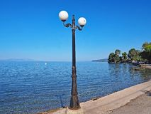 Lamp post on Nikolaiika Beach and the Corinthian Gulf in Greece. Beautiful sunny day from Nikolaiika Beach on the Corinthian Gulf in Greece on the Peloponnesian Stock Images