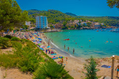 Beautiful sunny day in Sant Elm, with a beautiful blue water in Majorca, with people enjoying the weather, in Spain Royalty Free Stock Photos