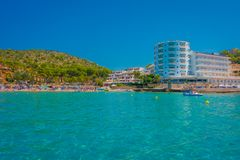 Beautiful sunny day in Sant Elm, with a beautiful blue water in Majorca, with some building in the horizont and people Stock Photos