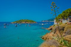 Beautiful sunny day in Sant Elm, with a beautiful blue water in Majorca, with people enjoying the weather, in Spain Stock Images