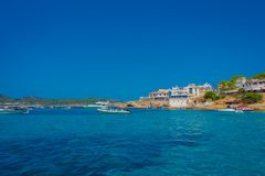 Beautiful sunny day in Sant Elm, with a beautiful blue water in Majorca, with some building in the horizont and people Royalty Free Stock Photos