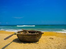Beautiful sunny day with a wooden boat on the yellow sand in the beach of Pantai pandawa, in Bali island, Indonesia Stock Photo