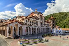 Beautiful sunny exterior view of modern Gorki Plaza hotel building in Gorky Gorod mountain resort in Sochi, Russia royalty free stock image