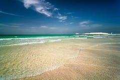 Jumeirah beach in Dubai with crystal clear sea water and amazing blue sky, Dubai, United Arab Emirates. Beautiful sunny Jumeirah beach in Dubai with crystal royalty free stock photography