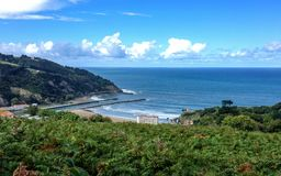 Beautiful sunny landscape of Basque Country over the beach of Deba, Pais Basco, Spain royalty free stock photography
