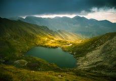 A beautiful, sunny mountain lake in Carpathians Stock Photo