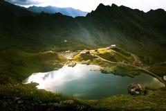 A beautiful, sunny mountain lake in Carpathians Stock Photos