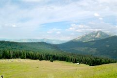 Beautiful  sunny mountain scenery in the holiday the day Stock Photos