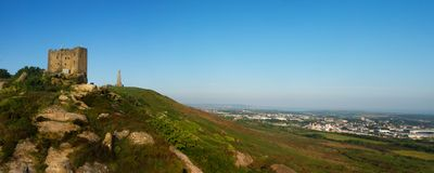 Carn brea hill covered in the afternoon sun. A beautiful sunny panoramic of Carn brea hill, Cornwall, England Royalty Free Stock Image
