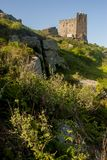 Carn brea hill covered in the afternoon sun. A beautiful sunny shot of Carn brea hill, Cornwall, England Royalty Free Stock Photo