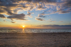 Beautiful sunny sky over the sea, the sunrise on the coast Royalty Free Stock Photo