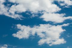 Beautiful sunny white cumulus on blue sky background.  stock photography