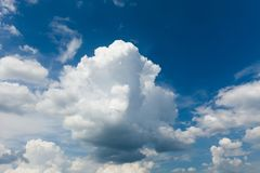 Beautiful sunny white cumulus on blue sky background.  royalty free stock photo