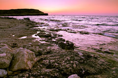 Beautiful sunrise. Over the sea surface of Stock Images