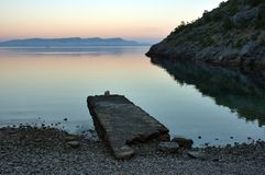 Beautiful sunrise. At the small peaceful beach stock photography