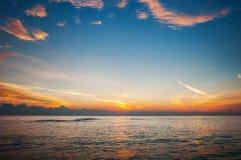 Beautiful sunrise above the sea. Beautiful sunrise over the sea with beautiful sky Royalty Free Stock Photo