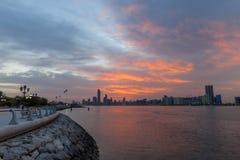 Beautiful sunrise in Abu Dhabi, United Arab Emirates. View on Corniche Royalty Free Stock Photo