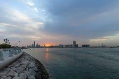 Beautiful sunrise in Abu Dhabi, United Arab Emirates. View on Corniche Stock Image