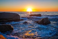 Beautiful sunrise in a bay with rocks in Costa Brava, Spain stock photo