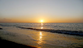 Beautiful sunrise on the beach.  Costa del Sol (Coast of the Sun), Malaga in Andalusia, Spain Royalty Free Stock Photography