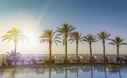 Beautiful sunrise at a beach resort Royalty Free Stock Images