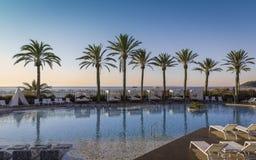 Beautiful sunrise at a beach resort Stock Photos