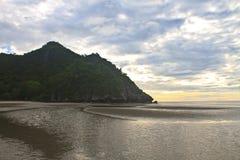 Beautiful sunrise on beach and tropical sea Stock Photo
