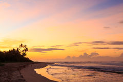 Beautiful sunrise at the beach in the tropics Stock Photos