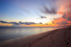 Beautiful sunrise at the beach in the tropics Royalty Free Stock Photos