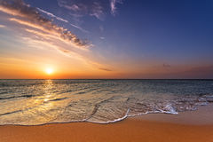 Beautiful sunrise at the beach in the tropics Stock Images