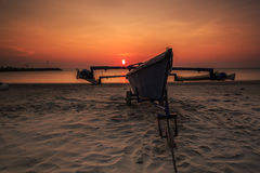 Beautiful sunrise and boat at Tanjung aru beach, Labuan. Malaysia. Tanjung Aru beach Labuan Malaysia. with beautiful sunrise Royalty Free Stock Images