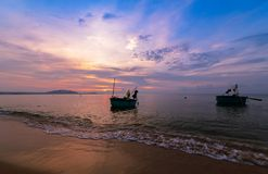 Beautiful sunrise and boats for fishing. On the sea in Mui Ne, Vietnam Stock Photography