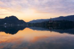 Beautiful sunrise and church on Lake Bled in Slovenia at the springtime royalty free stock photos
