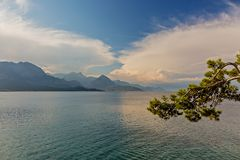Mountains and clouds are reflected in the sea water. City Of Kemer, Turkey. Beautiful sunrise city of Kemer, Turkey. Mountains and clouds are reflected in the Royalty Free Stock Images