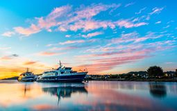 Beautiful sunrise clouds with smooth water of Larkspur, CA ferries. stock photography