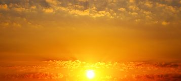 Beautiful sunrise and cloudy sky. Wide photo . Cloudy sky and bright sunrise over the horizon. Wide photo royalty free stock images