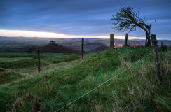 Beautiful sunrise dawn landscape of hills overlooking brightly l Stock Photography