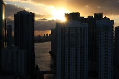 Beautiful sunrise in downtown miami. the sun breaks through the clouds and skyscrapers. view from the 38th floor royalty free stock photo