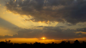 Beautiful sunrise and dramatic clouds on the sky. Royalty Free Stock Image