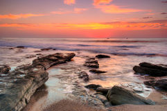 Beautiful sunrise. Early morning magic seascape as the sun is about to peep over the horison Royalty Free Stock Photos