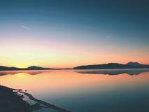 Beautiful sunrise at empty beach, Mediterranean Sea  island. Peaceful water level makes mirror Stock Photos