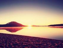 Beautiful sunrise at empty beach, Sea  island. Peaceful water level makes blue mirror Stock Photo