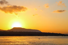 Beautiful sunrise and fishing boat at sea Royalty Free Stock Photo