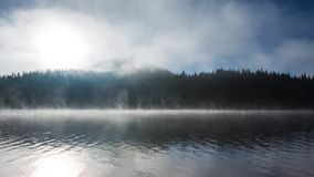Beautiful sunrise and fog over the mystic mountain lake, video stock video footage