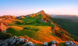 Beautiful sunrise in Gorbea with view of Arraba. Fields stock images