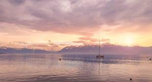 Sunrise over the Leman lake. Beautiful sunrise at the lake Leman. City of Lausanne, Switzerland. Flare effect Stock Image
