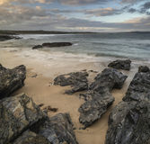 Beautiful sunrise landscape of Godrevy on Cornwall coastline in Stock Photography