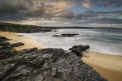 Beautiful sunrise landscape of Godrevy on Cornwall coastline in Stock Image